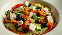 a bowl of greek salad with tomato, cucumber, white cheese, olive